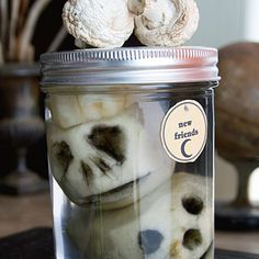 Halloween craft: Creep out guests with a collection of severed heads―really just peeled and cleverly carved apples in a jar full of white vinegar.
