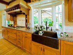 Looking for farmhouse sinks? Check out this gorgeous kitchen with a hammered copper sink on HGTV.com.