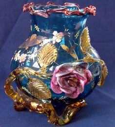 Good Stephens and Williams Amber- and Vieux-Rose Glass-Mounted Blue Glass Cabinet Vase, in the Japonesque taste, four. Steven Williams, Flower Mound, Heads And Tails, Flower Branch, Pottery Vase, Fashion Branding, Floral Motif, Earthenware, Blue Flowers