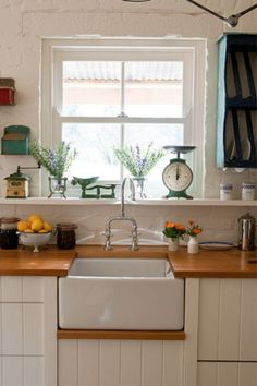 Red Brick Barn House -- Vintage pieces, from scales to a coffee grinder, keep the kitchen in period.