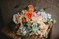 a beautiful bouquet with roses and succulents at gramercy mansion in baltimore, maryland