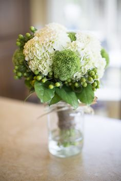 Hydrangea wedding bouquet - i like the softness of that moss in there