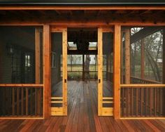 Beautiful wood deck/screen porch with sliding screen doors