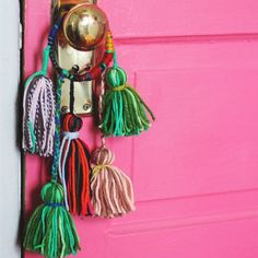 Simple yarn tassels turn into decorative knob bobbles. Easy, fun, and a great way to use up yarn scraps.