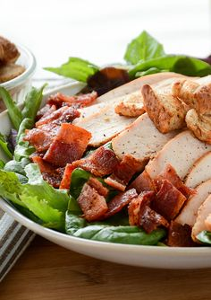 Tomato Basil BLT Salad | Adding our Seasoned Boneless Skinless Breasts to any salad is a winning idea.