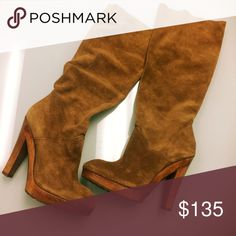 """Michael Kors Chestnut Suede Slouch Heeled Boots Michael Kors Suede Slouch Heeled boots in chestnut color. There are some nicks in the wood of the sole on the outside toe edges of both boots (pic'd). The suede is in great used condition. They have been gently worn. There is no size tag, but after trying them on I would estimate that they are a 9. I take a 9.5, and was able to squeeze them on, but they were quite snug. Heels measure 4"""" below the platform. No discoloration to the leather on the…"""