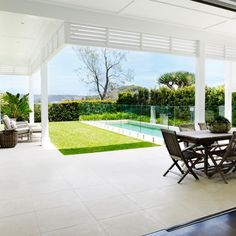 We designed and built this back yard patio, pool and garden area to be a relaxed space for easy outdoor entertaining. The louvres to the right create privacy screening to the neighbouring property. Outdoor Entertaining Area, Outdoor Tiles, Backyard Entertaining Area, Outdoor Rooms, Hamptons Style Homes, House Exterior, Garden Design Layout