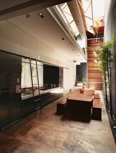 The cooking/dining space is the heart of the house, and is open to the elements.