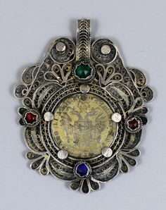 Bosnian folk coin pendant in silver filigree with glass stones.  Coin dated 1841.  The pendant is probably 19th century.