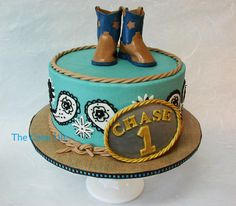 Birthday Cake Photos - Cowboy themed 1st birthday cake with fondant belt buckle and fondant cowboy boots.