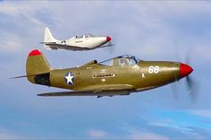 A Bell P-39 Airacobra and a Bell P-63 Kingcobra.