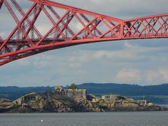 Inchgarvie Island beside the Forth Rail Bridge from South Queensferry, Scotland
