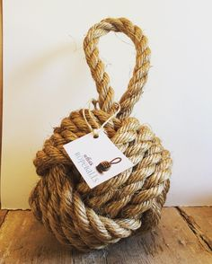 Premium weighted rope ball door stop. Ideal for home decoration for those seeking a nautical or rustic theme.   A perfect housewarming and wedding gift. Created by hand in England using high quality manila rope. Suffolk Ropeball door stops make fantastic additions to any home, particularly those seeking a nautical theme.   - Each ropeball door stop uses 8 meters of rope in it's construction - No added chemicals or bleach - Environmentally friendly, made from natural renewable resources…