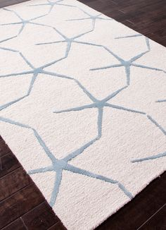 Bring the beach into your home with the Coastal Starfish Ivory and Blue Rug, from Indeed Decor, curators of unique home decor.