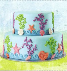 Wilton Cake Decorating Scavenger Hunt Cake Decorating - Sea Life All Around Cake. Magical marine characters charm this two-tier, fondant beauty. Our Fondant & Gum Paste Mold, Sea Life Designs, creates these lovely creatures, coral and waves. Wilton Fondant, Wilton Cakes, Fondant Cakes, Cupcake Cakes, Wilton Cake Decorating, Cake Decorating Supplies, Beautiful Cakes, Amazing Cakes, Sea Cakes