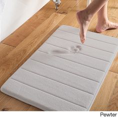Add the perfect finishing touch to your room with this bath mat. The white and grey solid color design adds charming style to your decor. Made of memory foam, PVC and polyester, this bath mat is durab