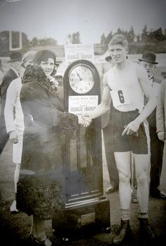 J Reynolds receiving a prize donated by Charlie Chaplin for being the fastest man to carry a hundredweight for a mile. Fastest Man, Charlie Chaplin, Marketing