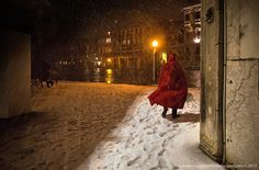 Photo Venetian Fairy Tale by Kah Kit Yoong on 500px  Torn from a novel. Venice in snow, the retreating figure in the red cloak, canal water sparkling in the yellow light. A winner for subject and composition alone.