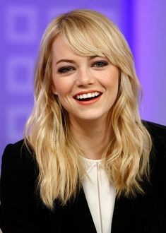 We'd love Emma Stone with any hairstyle, but she always has perfect bangs!