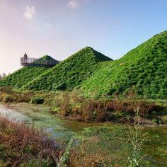 Studio Marco Vermeulen adds grass blanket over rooftop pyramids of Dutch island museum
