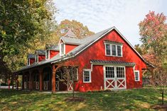 red horse barn with a two bedroom apartment above