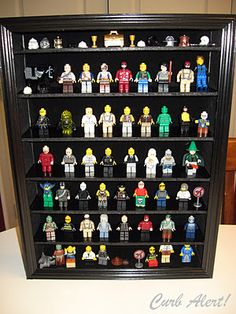 How to organize billions of Lego dudes? Show them off in an old photo display case.