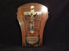 Beautiful holy water metal crucifix on a wood plaque Small glass holy water font Circa 1960s  Very good condition  Size : 11 inches Weight : 500 g.   ****TODAY DISCOUNT CODE ! VISIT OUR HOME PAGE !*** https://www.etsy.com/ca/shop/LesCurieux?ref=hdr_shop_menu