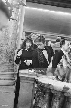 Juliette Greco and Alain Delon during Maria Callas's opera concert. I like his scarf.