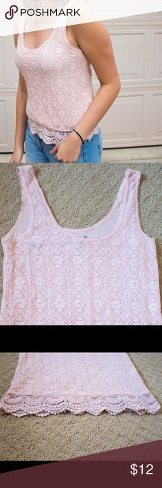 Pink solid knit designed American Eagle tank top Just in time for summer, this solid knit pink tank top adorned with flirty knit fringe is perfect for a night out or a casual day at the beach. The back is solid pink without the knit pattern with the fringe going all around. It measures 11 inches from the collar to the top of the fringe. American Eagle Outfitters Tops Tank Tops