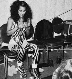 Cher lacing up to Roller disco in 1979