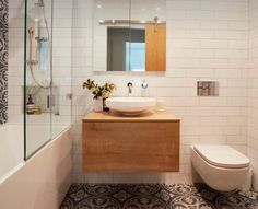 Feature tile wall in shower to match floor, hanging toilet, floating vanity, great tiny bathroom configuration