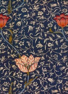 William Morris tulip against light colored tiny flowers design