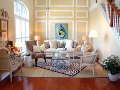 Rustic Yet Refined - 20 Coastal-Inspired Living Rooms on HGTV like arrangement of furniture on two rugs