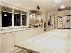 big kitchen with interesting splashback and scullery