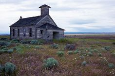 The old Dot schoolhouse(above) near Bickleton, Washington State, hasn't been consumed to the same degree as other forgotten buildings, but the purple heather surrounding lends a haunting quality to the 1930s structure.