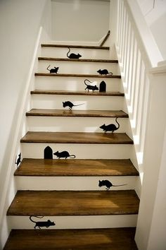 Martha Stewart's paper mice on stairs.  If you want something more permanent, you could use her free pattern (here: http://www.marthastewart.com/271198/paper-mice ) to make a stencil.