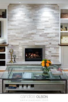 Enhance your stone fireplace with adjustable recessed lights.  The stone says permanence, and the fire is welcoming; a universal symbol of home • Stacked Stone Veneer • Stone Fireplace • #candiceolson #candiceolsondesign Stone Veneer Fireplace, Stacked Stone Fireplaces, Fireplace Design, Decoration, Great Rooms, Home Interior Design, Home Kitchens, House Plans, Candice Olson