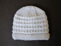 "Kensington Baby Hat Kensington Hats baby, child, teen DK yarn4mm & 5mm needles Tension ~ 22sts = 4"" (10cm) For a large premature, or early/small newborn baby Size: Width: 5"" (13cm)"