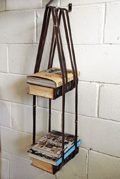Clever Leather Book Shelf http://dishfunctionaldesigns.blogspot.com/2012/07/belt-it-out-upcycled-repurposed-belts.html