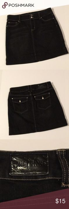 White House Blk Market Black Denim Skirt White House Black Market Black Denim Skirt.  Excellent condition.  Has a stretch the the denim so it's comfy.  No holes or stains.  Length is 16 inches.  Waist is 16 inches laying flat.  Smoke free pet free home. White House Black Market Skirts Mini