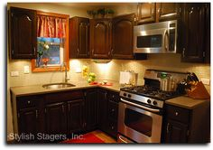 Put microwave above stove, combine stove and oven, smaller sink, tile back splash, lighting under cabinets.