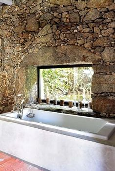 Nicely natural a fabulous drop-in bathtub set against a natural stone wall, with a small inset ledge window above the tub (via Haus Design: Gorgeous Bathrooms! Stone Cottages, Stone Houses, Future House, My House, House Bath, Natural Stone Wall, Beautiful Bathrooms, Modern Rustic, Rustic Art