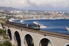 The Blue Coast train line outside Marseille. Color inspiration.  Love the tan of the bridge with the blue of the water.