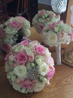 Beautiful brooch added to pink and ivory bouquet