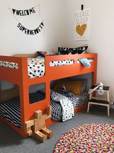 A bright orange bunk bed sets the scene for this gorgeous bedroom for two little boys by We Are Scout.