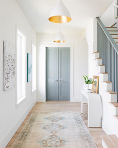 Hallway Inspiration : The contrasting gild interior of the Agnes Medium Pendant by AERIN makes a brilliant statement in this harmonious hallway ✨ Design by Barrow Building Group. Photography by Katie Charlotte. Home Interior Design, House Design, Interior Design, House, Home Remodeling, Home, Hallway Designs, White Interior, Home Decor