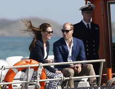 Kate's brown hair was blown about in the wind as the couple travelled to St…