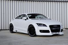 Audi TT. Offered as a curvy all-wheel-drive coupe or convertible, the base TT with its modestly powered 211-hp 2.0-liter turbocharged four-cylinder engine and six-speed dual-clutch automated manual transmission can sprint to 60 mph in a lively 5.3 seconds and get an impressive 23/31 mpg.