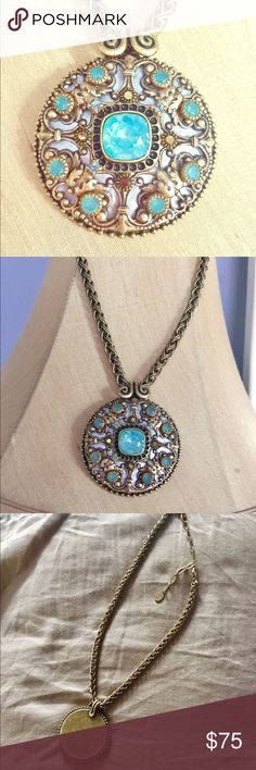 Authentic Micheal Golan gold medallion necklace This necklace is stunning in person! Large jewel covered round medallion (large size, the circumference slightly smaller than a soda can). Large aquamarine blue stone in the center, surrounded by smaller blue stones and fiery red/orange stones that reflect all colors in the light. Mother of pearl background, all set in a bronze-gold colored metal. Adjustable length 16-18 inches. Amazing weight and quality. Authentic price with designer tag. You…