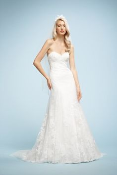 Hourglass figure. Dress Dos: A-line dresses with a dropped waist, like this frock fromWatters show off an hourglass bride's balanced figure...